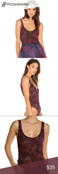 Free People Bodysuit NWT FP bodysuit!  So fun & flirty!!  Great for going out & concerts! Sold on Nordstroms, revolve, ASOS, Free People.  This will be a great addition to your wardrobe! Xo Free People Tops Tank Tops