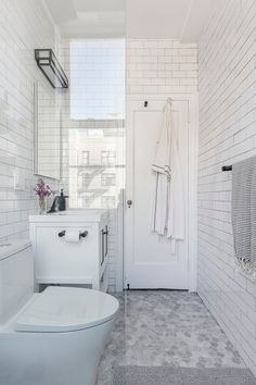 """A bathtub converts into a walk-in shower to provide accessibility for an aging renovator. """"My bathroom appreciation grows one step at a time! For years, when I went to other people's homes, I wished I could have spaces like these. Now I do. I am so very grateful"""", Mickey shared. Kitchen And Bath Remodeling, Bathroom Renovations, Home Renovation, Bathrooms, Mickey Bathroom, White Tile Backsplash, Dual Flush Toilet, Walk In Shower, All Modern"""
