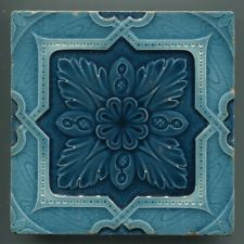 An Art Nouveau relief moulded tile by Alfred Meakin, registered design, c1903
