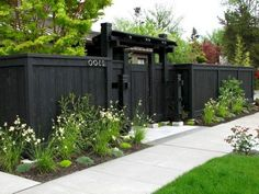 front garden fencing ideas front yard fence privacy fence dark fence stock hill landscapes inc Cheap Privacy Fence, Privacy Fence Landscaping, Privacy Fence Designs, Backyard Privacy, Backyard Fences, Garden Fencing, Backyard Landscaping, Garden Privacy, Backyard Ideas