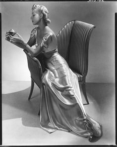 Helen Bennett in a gown of liquid looking satin by Jean Patou by Lusha Nelson 1935