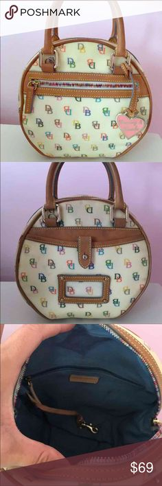 🎀 Dooney & Bourke🎀 Multi Color Signature Satchel Authentic and in good condition! 100% leather handles and trim. It has light marks on the outside from normal use but not bad and the inside could use a cleaning. I haven't attempted but I am sure you can get it looking like new! Inside zipper and leather strap with hook for attaching keys etc. One outside zipper, back pocket with leather clasp and clear window Card holder. Rainbow colored zipper teeth and DB lettering on the outside. Pretty…