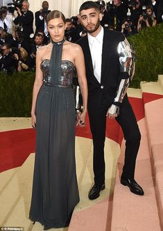Suave: Zayn Malik- pictured this year at the Met Gala with Gigi Hadid, has been crowned GQ's Best Dressed 2017 in the publications first-ever Reader's Play-offs