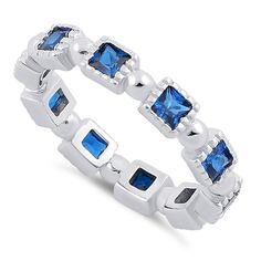 Sterling Silver Princess Cut Blue Spinel Eternity CZ Ring