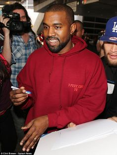 His own best advert! Kanye wore the red 'I Feel Like Pablo' hoodie as he arrived at the Los Angeles airport