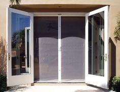 Retractable screen door for french doors