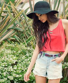 loose belly shirt, simply color/ pattern; chunky necklace; high waisted shorts with fun belt; converse low tops