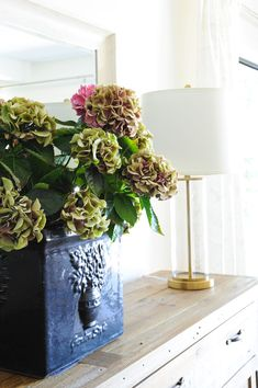Use fresh flowers, like these hydrangeas, to enliven any space in your home. Brick And Wood, Vancouver Island, Hydrangeas, White Paints, Plant Decor, Fresh Flowers, Hgtv, Indoor Plants, House Tours