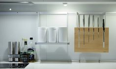 bulthaup b3 functional wall rail with hanging elements, perfect for cooking.