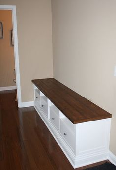 Bench seat - 2 Ikea Hemnes TV consoles, wood plank top, and baseboard.