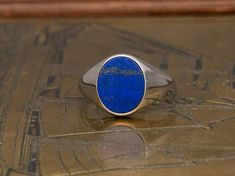 Man Ring 2018 made with LAPIS natural gemstone. A simple geometric design combined with #goldsmith techniques to reborn a top classic piece of #signetring . Worn at #pinkyring finger or as an band or a unique combination, this #trending mens ring comes in #fashion again. Buy it now made with fine materials and high standards by #danelian #jewellery. #trending2018 #lapis #lapislazuli #oval #lapis #ring #man #ring