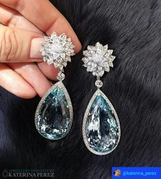 Chrysanthemum earrings by the British jeweller Theo Fennell. They feature over 95carats of Aquamarine! The drops can be taken off and flowers worn as studs.