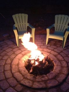DIY patio firepit. Love firepits that are actually in ground and not raised up.