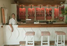 LYFORD CAY CLUB: The Bahamas. The Coral Pink an excellent color to compliment the white 'palm leaf' woodwork. The charmingly primitive barstools are winning.