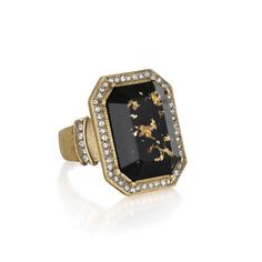 """Who doesn't need a black ring? Inspired by the Italian phrase """"la dolce vita,"""" meaning """"the sweet life,"""" this captivating cocktail ring features a jet-black center with speckled gold leaf accents. Outlined by sparkling black diamond pavé, a softened geometric silhouette looks naturally chic in romantic, antique gold plating. Both dazzling + detailed in design, this on-trend treasure is a definite must-have this season! ON SALE NOW $24 WAS $48"""