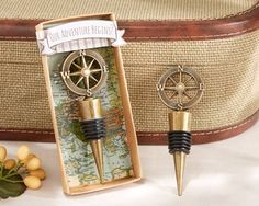 Our Adventure Begins Compass Design Bottle Stopper (Kate Aspen 11145NA) | Buy at Wedding Favors Unlimited (https://www.weddingfavorsunlimited.com/our_adventurebegins_compass_design_bottle_stopper.html).