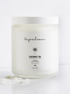 Kapuluan 8oz Cold Pressed Coconut Oil | Deeply nourish and moisturize the skin with this 100% raw, cold-pressed organic coconut oil. Rich in antioxidants, this one-ingredient superpower is a wonderful remedy to fight against the bacteria that causes acne and intense skin drying.    * 8 oz.   * Intended for all skin types.   * **How to Use:** Coconut oil hardens in cold temperature and may be difficult to squeeze out. If so, rub in hands or use warm water to soften, and store at room…