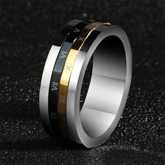 The latest innovation in fidgets. Our Roman Password Titanium Fidget Ring for men and women. #black #gold #silver #ring #unique #gift #fidget #spinner