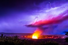 This photo shows forks of lighting striking a plume of volcanic ash in Hawaii, turning the sky incredible shades of pink and purple.