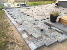 Pavered path using Benders Troja Antik Graphite 210x140mm and Labyrint side of same brick as border.