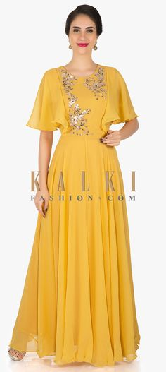 Laadesar Mustard Georgette Anarkali Gown Embellished In Zari And Sequin Work Call or Whatsapp on or visit insta page WOMN CLOTHING. we are designer studio specialized in custom designer dresses. No CASH ON DELIVERY, worldwide delivery. Indian Gowns, Indian Outfits, Indowestern Gowns, Heavy Dresses, Drape Gowns, Anarkali Gown, Indian Designer Wear, Dress Collection, Dress Patterns
