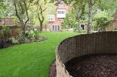 Curved bespoke woven willow screen