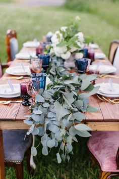 Rustic watercolor wedding inspiration as the glasses are a range from peachy pink through cobalt to purple. Add a few other watercolour elements such as place cards that are washed in the same pallete. Jewel Tone Wedding, Floral Wedding, Pallet Wedding, Rustic Wedding, Enchanted Wedding Decor, Beauty And More, Outdoor Wedding Inspiration, Wedding Ideas, Green Centerpieces