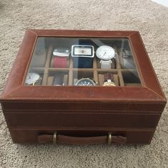 Fossil Jackson Leather Watch Box Great condition with tags still attached. Some marks on the leather I've never tried to clean off. Barely any wear to leather, but adds to a rustic look. Faint marks in the interior lining of drawer. It's always sat in my closet. Holds 10 watches with a divided drawer on bottom for accessories/parts. Fossil Accessories Watches