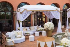 We worked on this fabulous event with Sonia Sharma Events at a private estate. These beautiful images come from Dina Douglass of Adrena Photography. Produced and designed by Sonia Sharma Events, this event called for pristine lounge furniture. Our day bed with a custom white cover was a perfect selection for this sophisticated event. A gorgeous shot in daylight shows off our White and Gold Custom Canopies and our White Ibiza Furniture Collection with gold accent tables provided shade and…