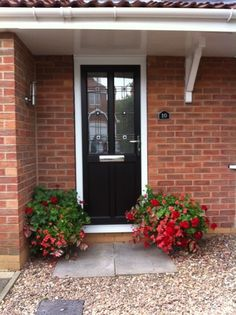 Traditional UPVC front door in black https ...