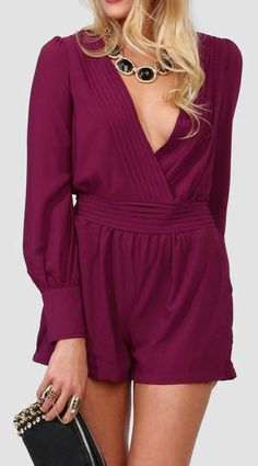 Love this burgundy romper paired with a black and gold bib necklace