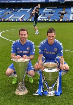 Juan Mata and Fernando Torres. Champions League and Europa League trophies. The first club to hold both trophies at the same time.Chelsea FC's 2013 Lap of Honour