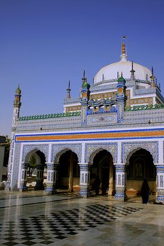 Shrine of Shah Abdul Latif Bhittai  Shah Abdul Latif Bhittai (1689–1752) (Sindhi: شاھ عبدالطيف ڀٽائيِ), was a Sufi scholar and saint, and is considered as the greatest poet of the Sindhi language. He settled in the town of Bhit Shah in Sindh, Pakistan. His most famous written work is the Shah Jo Risalo. His shrine is located in Bhit and attracts hundreds of pilgrims every day.