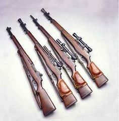 The M1 Garand rifle (l.) was adapted for sniping with the addition of a Griffin & Howe side mount and the M82 scope as the M1C (second from l.), it lies next to an M1D with an M84 scope attached to a barrel mount. At top right is a USMC 1952 sniper rifle with Kollmorgen USMC scope in a Griffin & Howe mount.