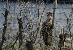 A North Korean prison policewoman stands guard behind fences at a jail on the banks of Yalu River near the Chongsong county of North Korea, opposite the Chinese border city of Dandong, May REUTERS/Jacky Chen Bangkok, Kim Jong Un, Persecuted Church, Human Rights Organizations, New Roman, Human Rights Watch, North Korea, Far Away, Dios
