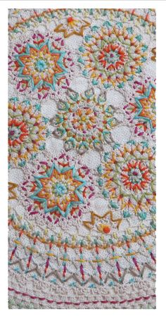 Ernest Hope - embroidered doilies grouped together to make a quilt - Beautiful!!