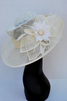 Kentucky Derby Hat, Tea Party Hat & Church Hat! Make your statement with this stunner!  *100% Brand new, hand made and high quality. *Head circumference is adjustable *Material: Polyester *Crown height: 4 *Brim length 5.5 *Beautiful detail *Available in different colors  **Elegant fashion flouncing, vogue hats are perfect for horse racing events, church, the Kentucky derby, weddings, garden tea parties and charity events. ** Available to ship next business day.  More Derby Hats…
