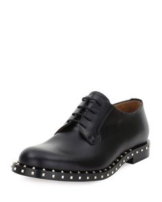 ValentinoRockstud Studded Lace-Up Derby Shoe, Black  $1,395.00 is Product Price.  FREE SHIPPING, FREE RETURNS  BGF17_N3XRJ   For in-store inquiries, use sku #1820670      Valentino calfskin leather derby shoe.     Metal studded details across midsole and heel.     Medallion toe.     Lace-up front.     Unlined.     Rubber sole.     Rockstud at heel counter.     Made in Italy.