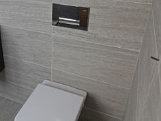 more masculine warm grey tile for the bathroom or powder room/cloakroom by Stonewood uk