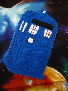 TARDIS embroidry on spacey wacey fabric. Made by FiberAlchemist. Doctor Who Fill-a-box Swap.