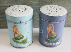 "Add a touch of elegance to your coastal kitchen or nautical party with these food-safe Sea Beauty Salt & Pepper Shakers. Not only is it perfect for a party, these cute and sturdy tin shakers make a great gift or accent piece for any kitchen. Shakers measure 4 1/4"" x 3"" each."