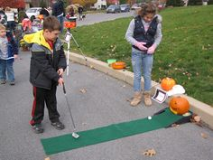 For this game we had a mini golf stand set up and there was a pumpkin on top of the hole with a large mouth in it. to get the prize for this game you had to get the ball in the mouth of the pumpkin.
