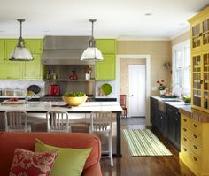 These beautiful chartreuse cabinets compliment the earthy tan wall accent behind them in this eclectic island-shaped kitchen.