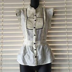 Anthropologie Mine pin tucked blouse so cute Features: pin tucked detail on chest area, short flutter sleeves, cream and black, tie back, button front. Tag says large but I would say more like a medium. Too tight for me :( Anthropologie Tops Blouses