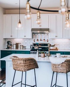 Awesome kitchen, I love the white subway tile with the contrasting cabinet colors