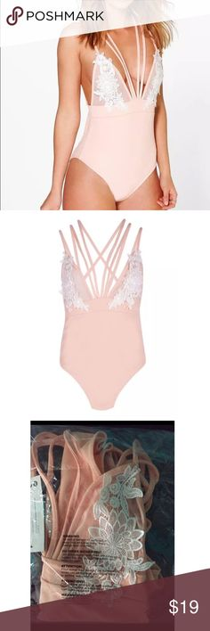 Women's Multi Strap Floral Sheer Mesh Bodysuit Strappybodysuits are big news for nights out & this evening bodysuit adds edge to any late night look. Pair with pencil skirt, trousers, ordenim cutoffs for a chic look! Boohoo Tops