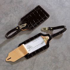 Abas for Levenger Luggage Tag The distinctive pattern and bold clasp on this leather luggage tag help you spot your bag