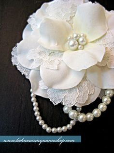 #DIY hair flower - she tells how she did this and then links to another tutorial that she followed. dollar store flowers taken apart, put lace between layers, sew pearls in center top, then add pearl strings.