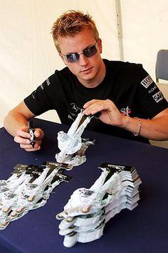 Kimi Raikkonen (FIN) McLaren signs cutouts for the fans Formula One World Championship, Rd17, Japanese Grand Prix, Preparations, Suzuka, Japan, 7 October 2004
