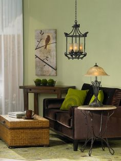Rich brown and light green living room design.